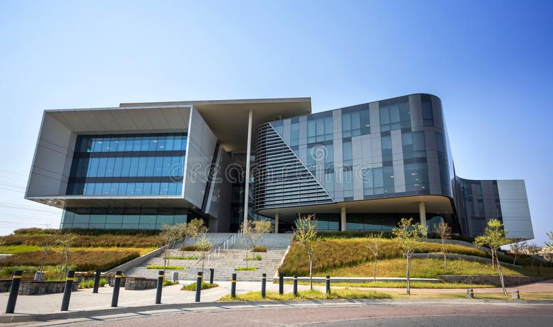 Modern office building with concrete and glass exterior. royalty free stock image
