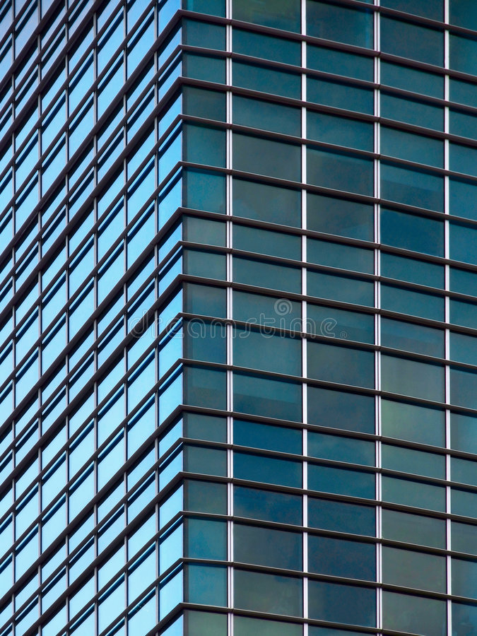 Modern office building corner. With different illumination royalty free stock images