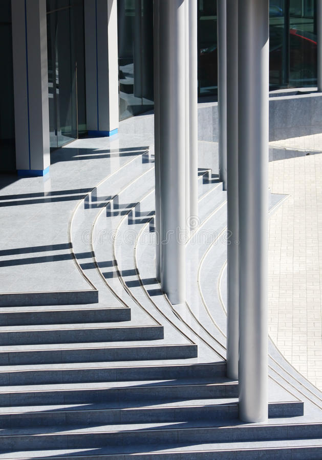 Modern office building entrance, steps and pillars royalty free stock photography