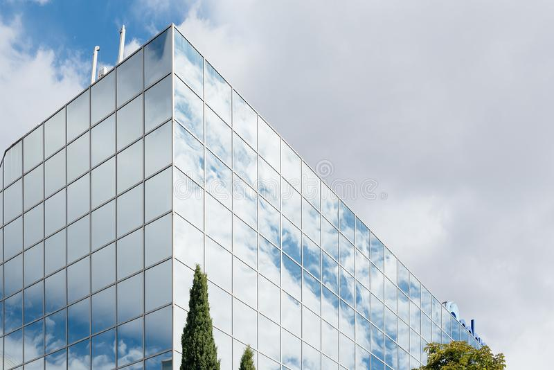 Modern office building exterior. And reflections on glass. Low angle view stock photo
