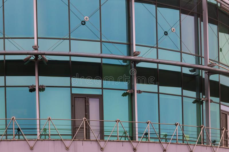 Modern office building with facade of glass stock photo