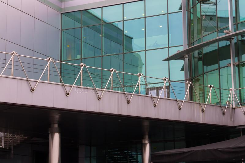 Modern office building with facade of glass stock images