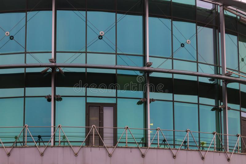 Modern office building with facade of glass close-up stock photo