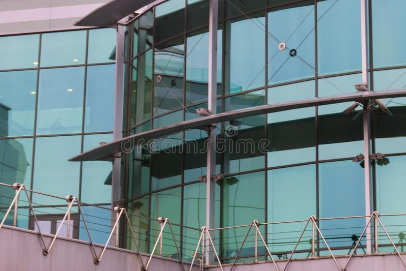 Modern office building with facade of glass royalty free stock photos