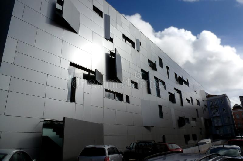 Modern office building facade in Lisbon, Portugal with aluminum cladding royalty free stock photography