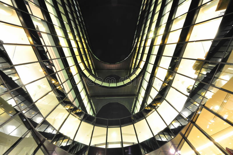 Modern office building lit up windows at night royalty free stock image