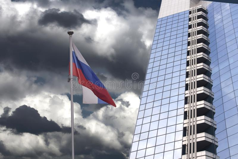 Modern office building with Russian flag royalty free stock image