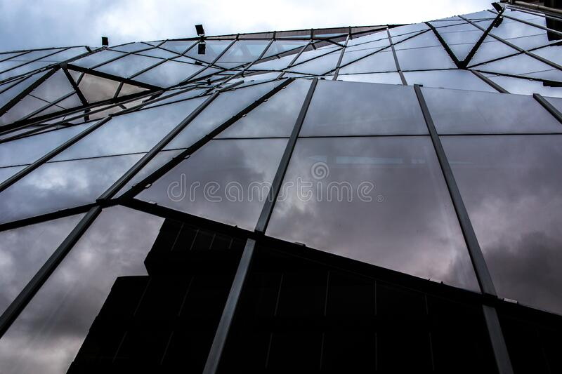 Modern office building seen from below. Windows stock photo