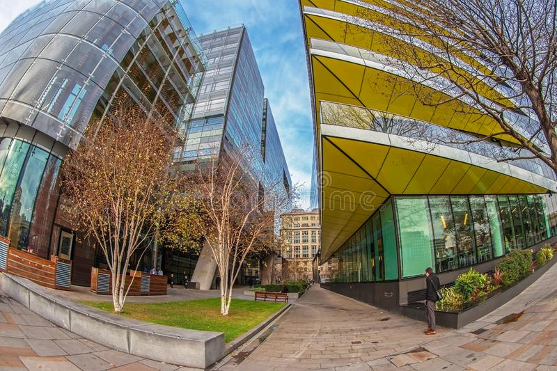 Modern office buildings on the bank of the river Thames. LONDON, ENGLAND - NOVEMBER 27, 2017: Modern and spectacular office buildings on the bank of the river stock photos