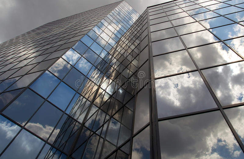 Modern office buildings with clouds reflected on