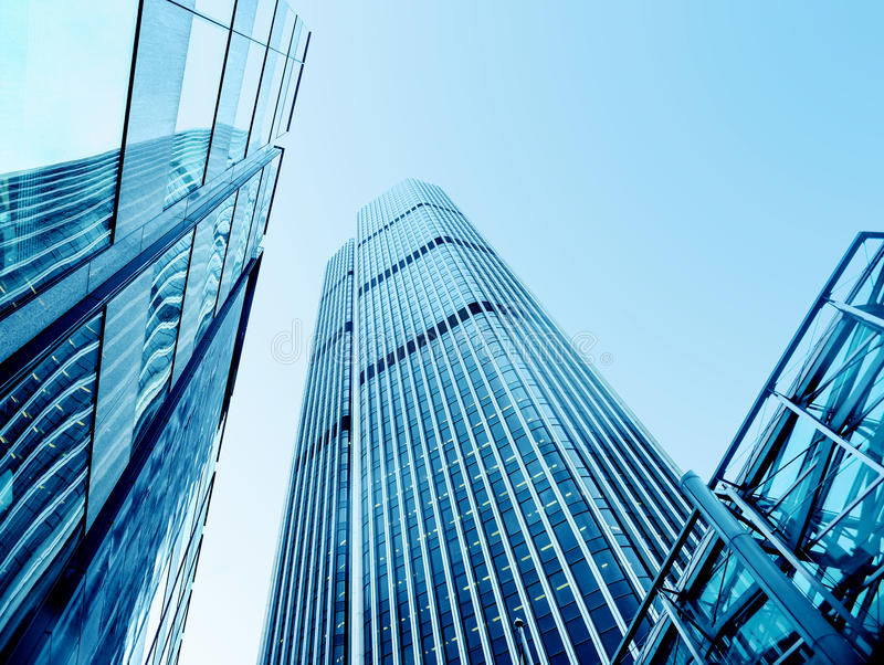 Low Angle View To Light Glass Buildings Of Business Center: Modern Office Buildings From Low Angle View Stock Image