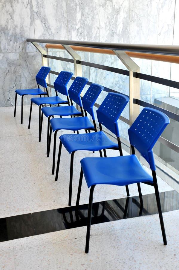 Modern office chairs. Blue colour stock photos