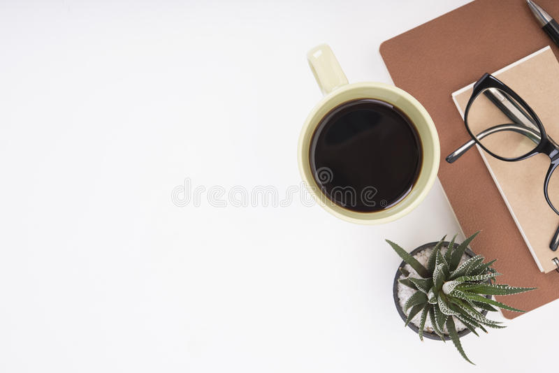 Modern Office desk with notebook, pen, paper book and coffee cup stock image