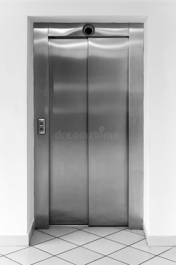 Modern office fragment, shining elevator doors. Modern office fragment, shining metal elevator doors stock photo