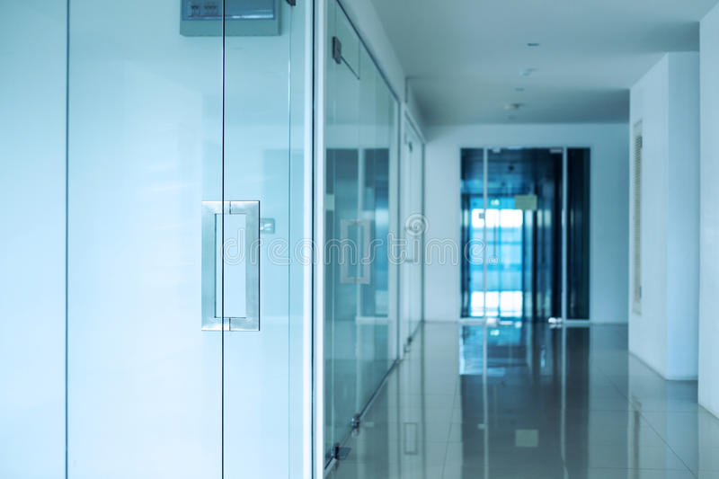 Modern office interior, Blue toned, selective focus on doorknob royalty free stock photos