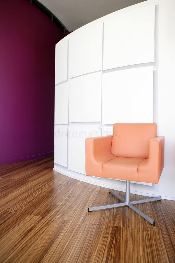 Modern office lobby with orange chair. Modern office lobby interior design, orange leather chair , wooden floor stock photos
