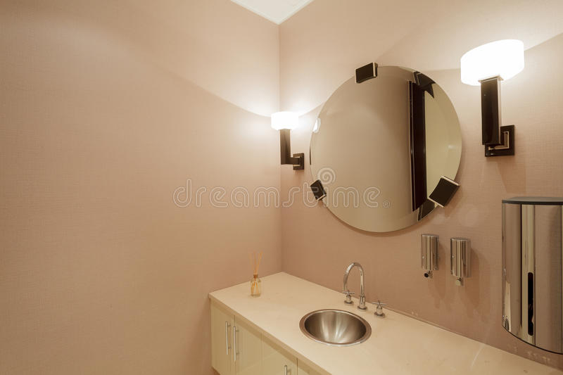 Modern office washroom interior. With mirror and lamps royalty free stock photo