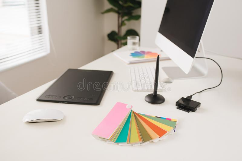Modern office workplace with desktop computer, stylus and tablet stock photos