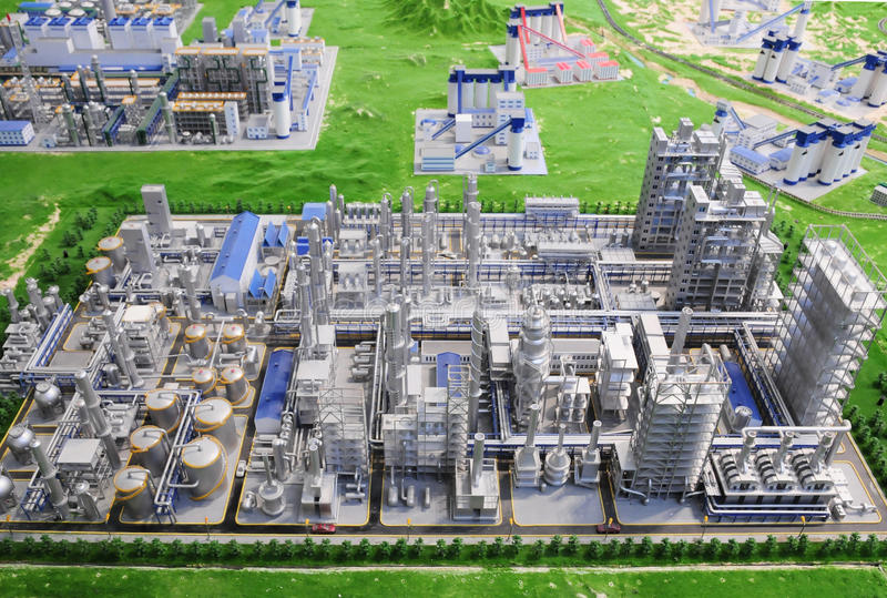 Modern oil refinery factory. With green technology stock photography