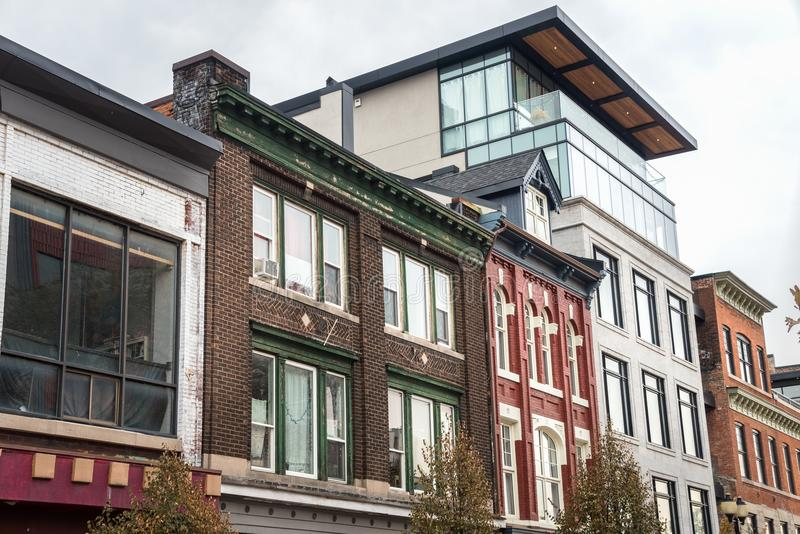 Modern and Old Architecture in Hamilton, ON, Canada. Modern Residential Building between Traditional Brick Buildings under Cloudy Autumn Sky. Hamilton, ON royalty free stock photo