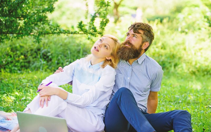 Modern online business. Couple youth spend leisure outdoors working with laptop. How to balance freelance and family. Life. Couple in love or family work royalty free stock image