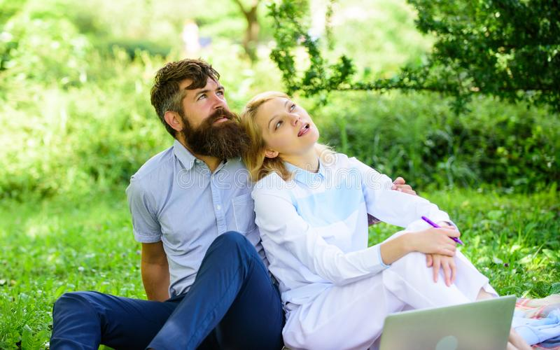 Modern online business. Couple youth spend leisure outdoors working with laptop. How to balance freelance and family. Life. Couple in love or family work stock photography