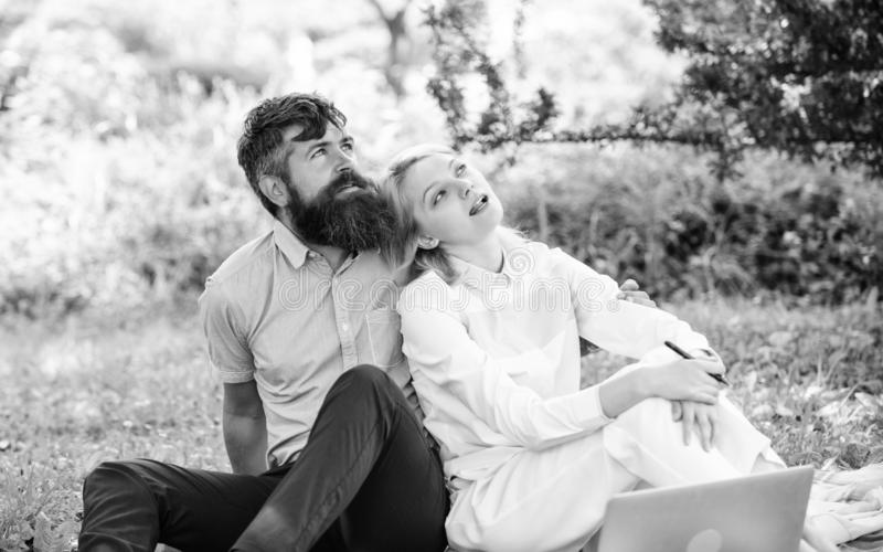 Modern online business. Couple youth spend leisure outdoors working with laptop. How to balance freelance and family. Life. Couple in love or family work royalty free stock photography