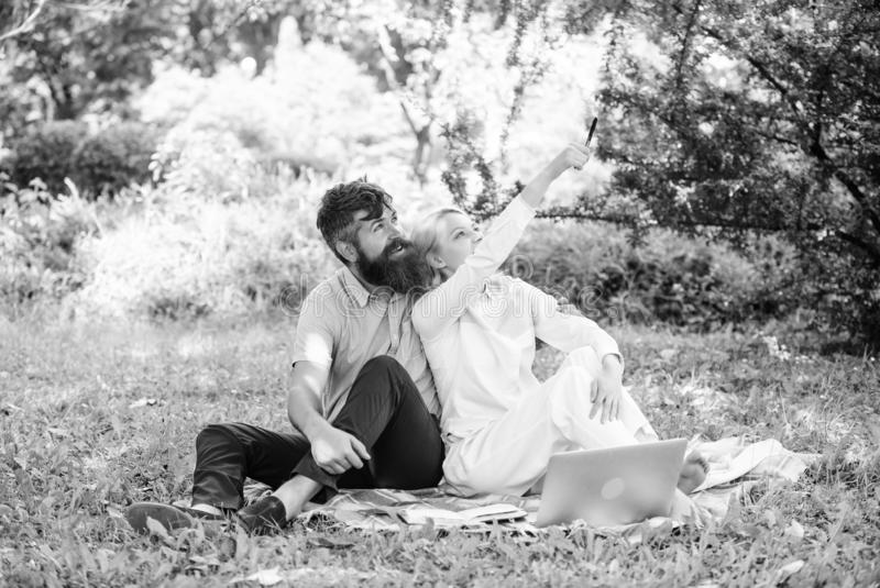 Modern online business. Freelance life benefit concept. Couple youth spend leisure outdoors working with laptop. How to stock photo