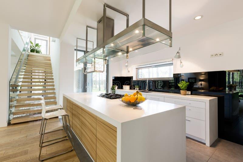 Modern kitchen in minimalistic apartment royalty free stock photo