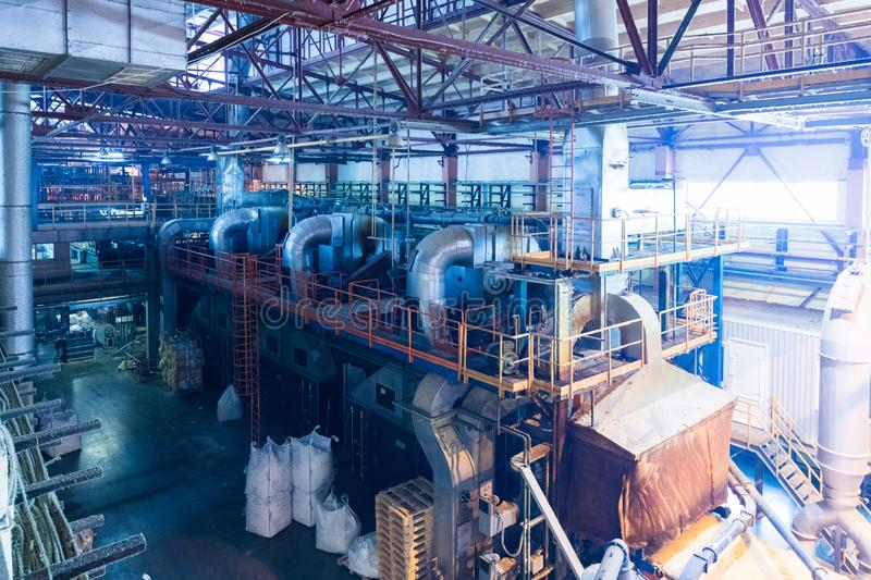 Fiberglass production industry equipment at manufacture background. Modern operational plant with pipes producing fiberglass heavy industry machinery stock photos