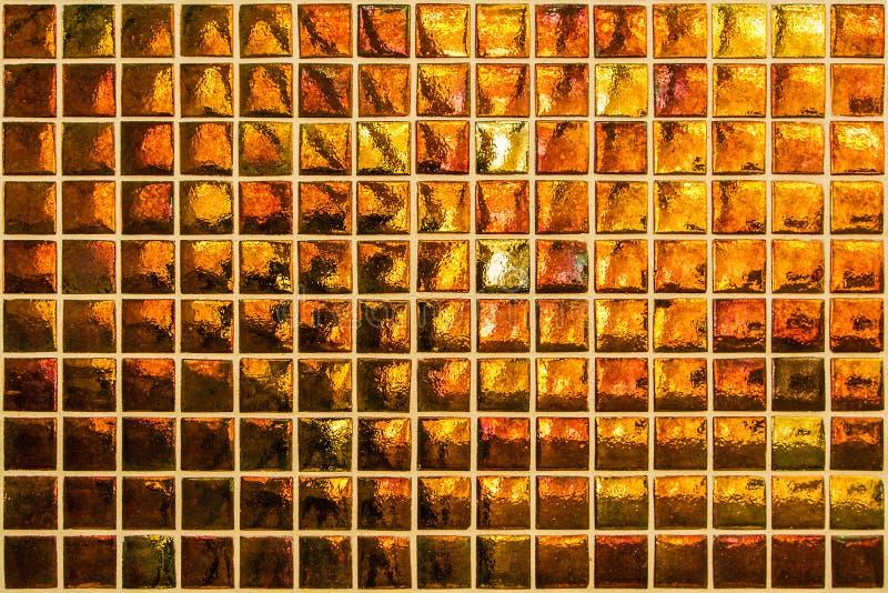 Modern oranje mozaïek met kleine vierkanten royalty-vrije stock foto