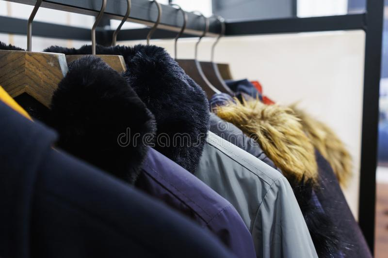 Modern outerwear in a shop on a hanger. royalty free stock photography