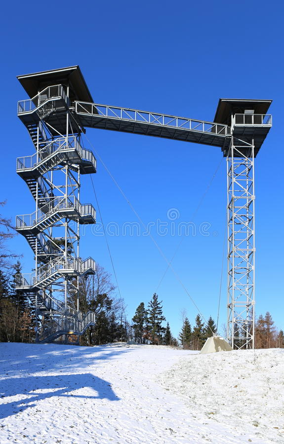 Modern outlook tower. Outlook tower consisting of pair of towers and bridge stock images