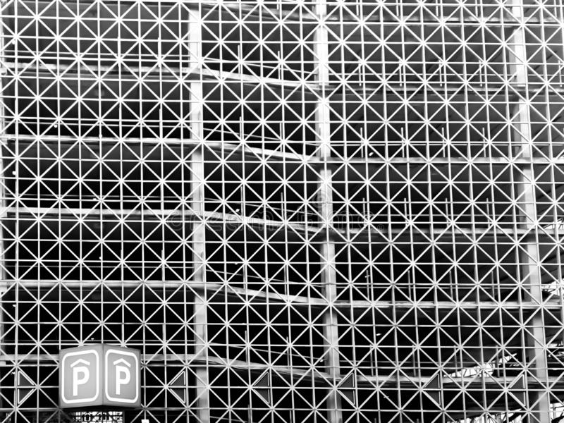 Modern parking lot building with abstract design. Black and white, line, detail, background, grid, iron, metal, metallic, old, steel, texture, brown, grunge royalty free stock image