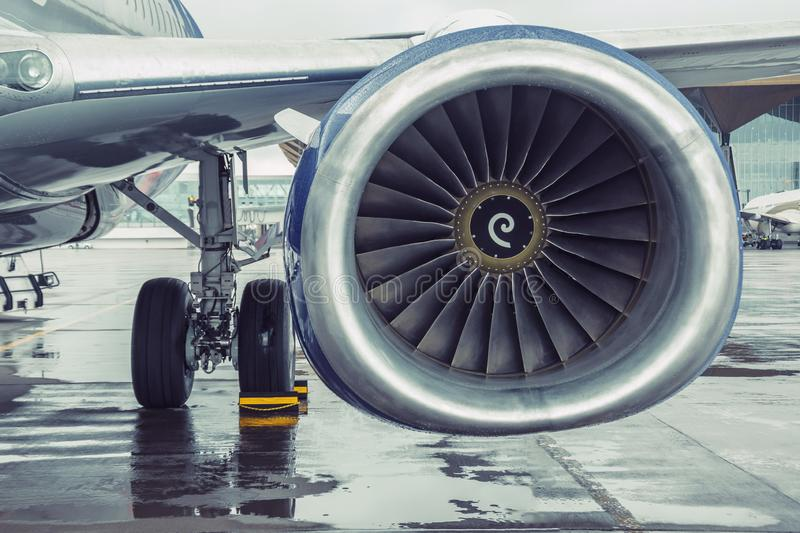 Modern passenger aircraft liner parked, view of the wing engine stock image