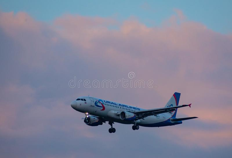 Modern passenger aircraft in the sky royalty free stock images
