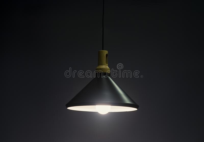 Modern Pendant light lamp illuminated, Elegant Chandelier illuminated stock photo