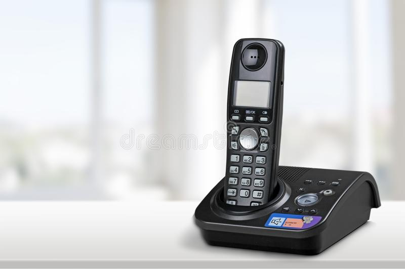 Cordless modern Phone and base station isolated on royalty free stock image