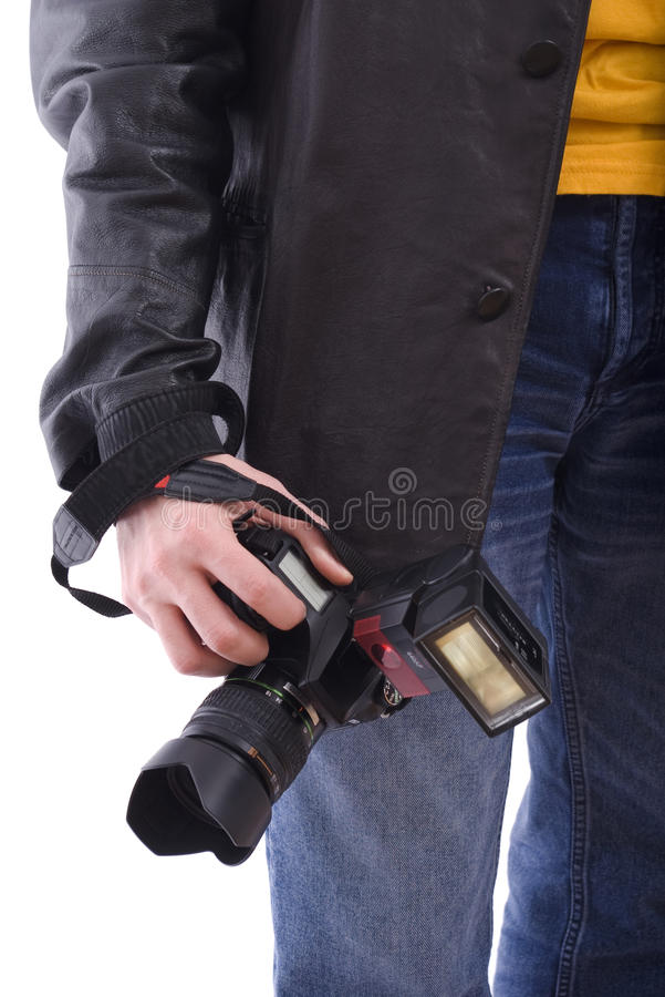 Modern photo SLR camera in photographer's hand stock image