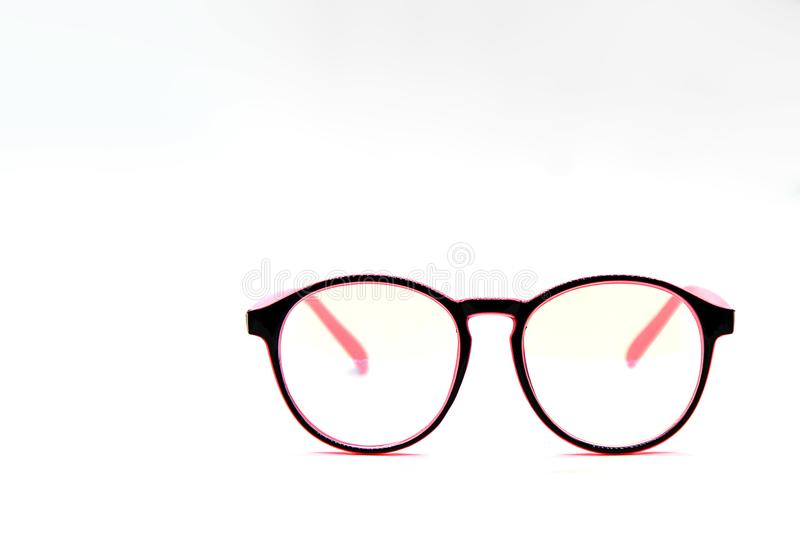 Modern Pink and Black eye glasses isolated on white background stock photography