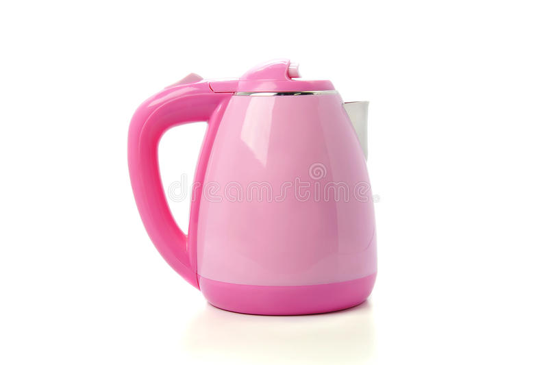 Modern pink electric kettle isolated on white background.  stock image