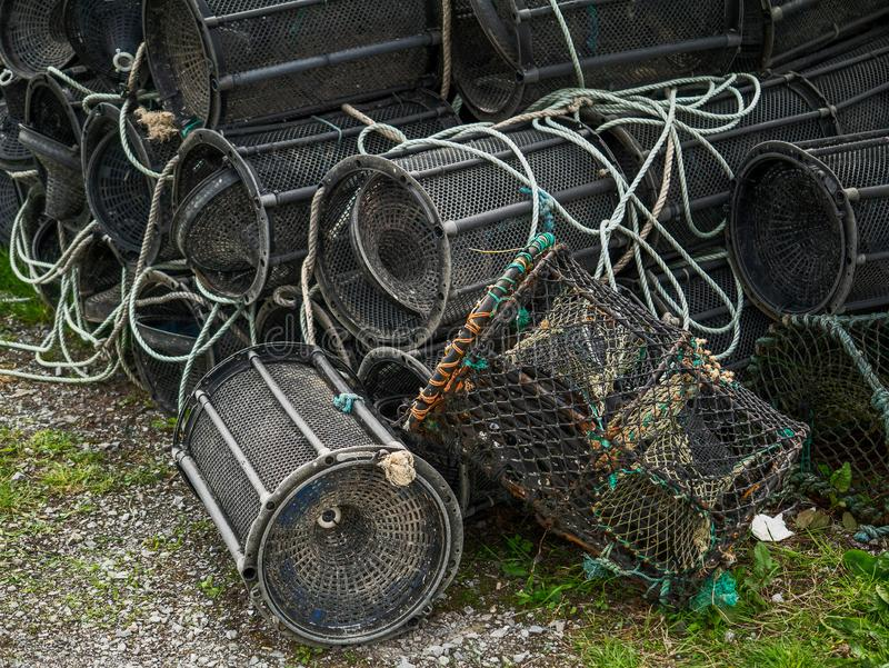 Modern plastic fish and crab traps ashore. Fishing industry. Modern plastic fish and crab traps ashore. Fishing business and industry stock photo