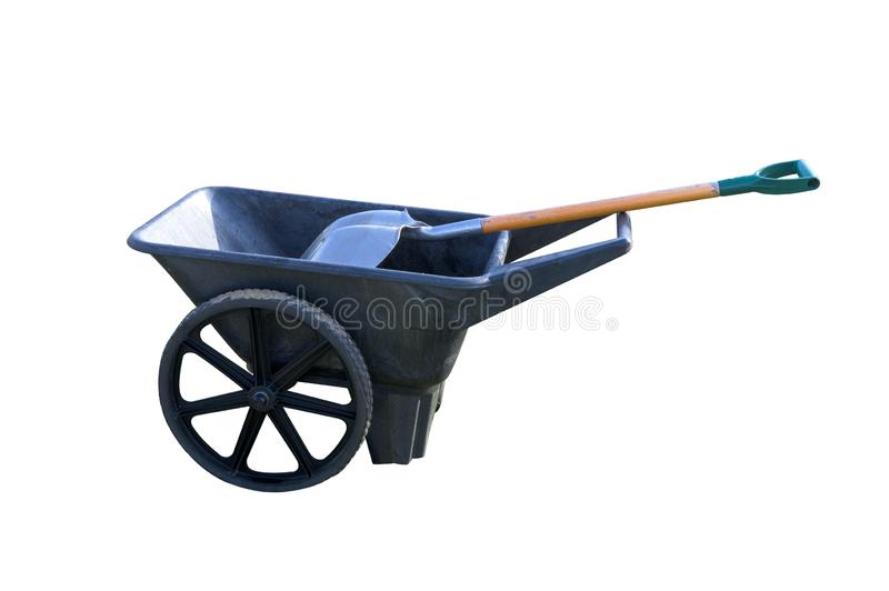 A modern plastic wheel-barrow with a shovel isolated on a white background royalty free stock image