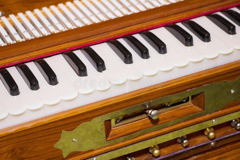 Modern portable harmonium, traditional keyboard musical instrument. stock photography