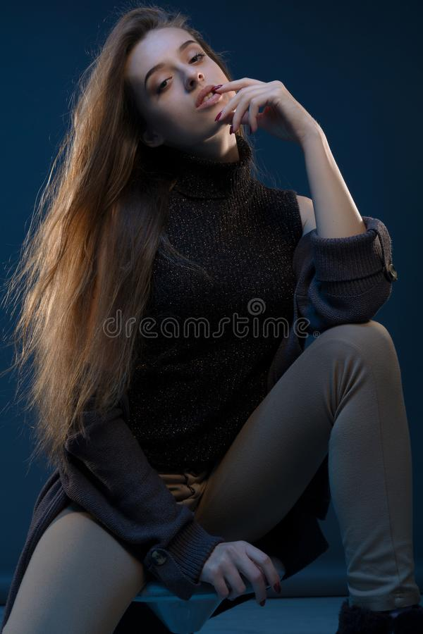 Modern portrait, colorful high fashion beauty shoot of fashion model girl with fashion make up on a background in a stock photography