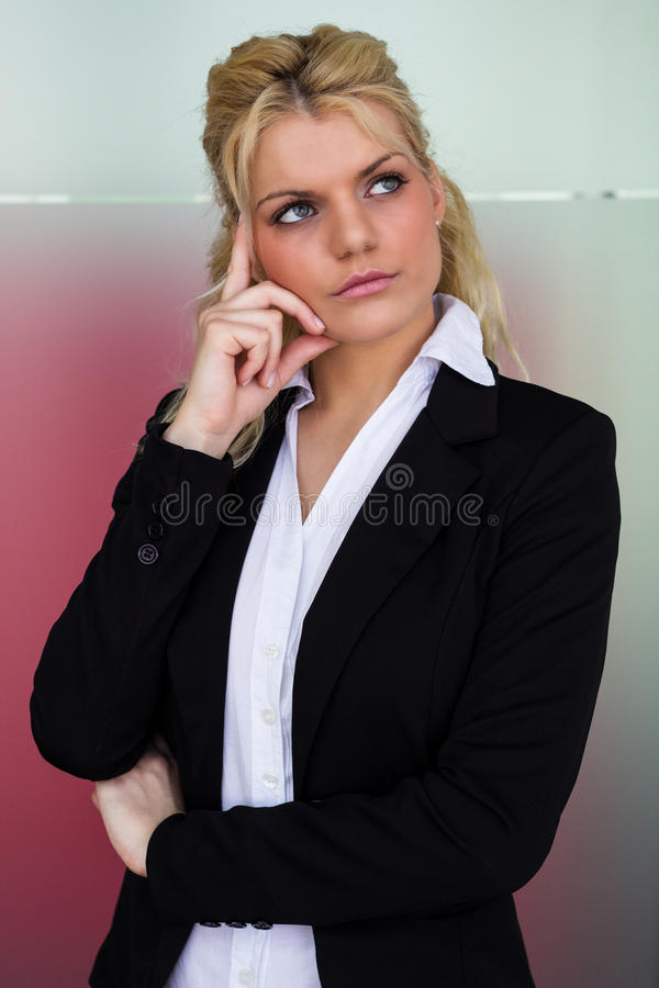 Modern portrait of a young professional businesswoman thinking stock photography
