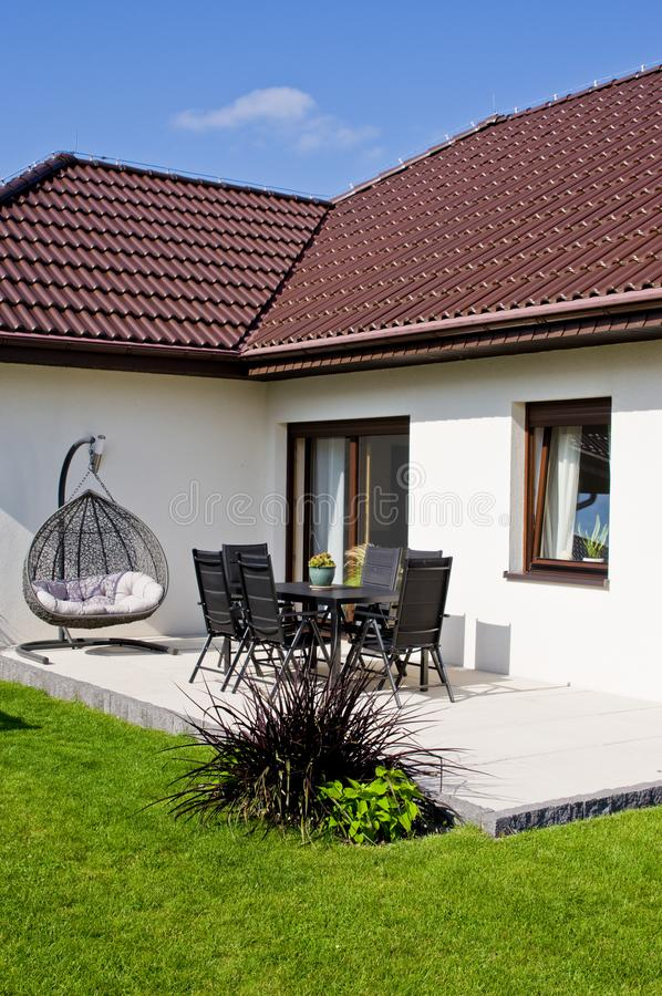 Modern private house terrace design in summer stock photography