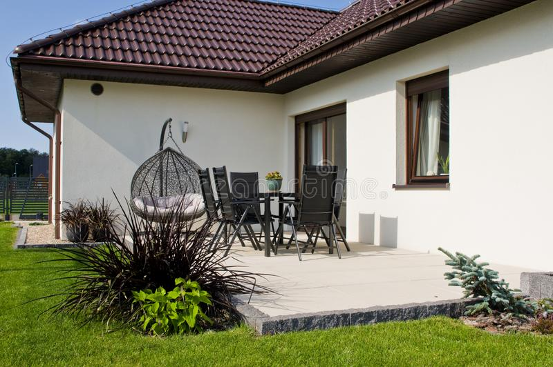 Modern private house terrace design in summer royalty free stock image