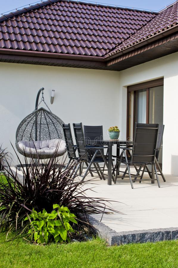 Modern private house terrace design in summer royalty free stock photos