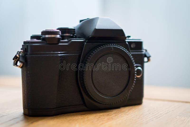 Mirrorless Digital Camera devise. Modern professional Mirrorless Digital Camera on a wooden desk royalty free stock image